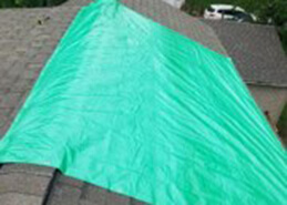 tarp covering damaged roof